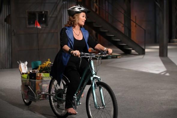 Arlene Dickinson riding bike with Maya Cycle bike trailer