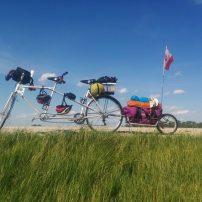 Tandem bike and loaded bike trailer parked
